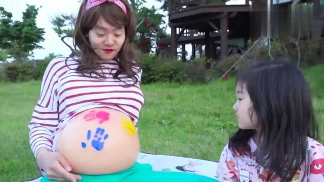 孕妇挺大肚子拍孕妇照