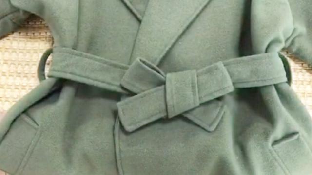 【风衣蝴蝶结的系法图解】大衣蝴蝶结的打法 风衣腰带... _买购网