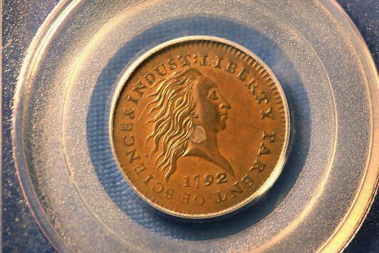 美国一枚面值10美分硬币拍出160万美元_点购收藏网