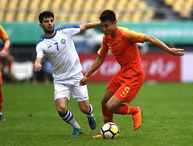 中国1∶0击败乌兹别克斯坦 国足仍保留出线希望