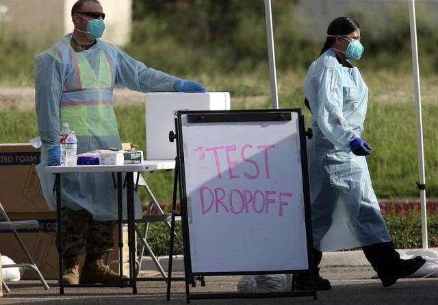 感染人数激增,美国病毒检测点排起长龙
