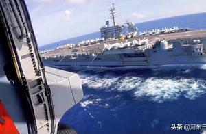 被无人机拍烦了,美军航母直升机开始演练击落无人飞行器