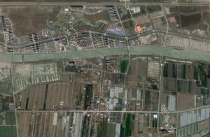 江苏南通启东市人口最少的镇,位于崇明岛上,和市区隔江相望
