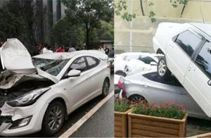 公交车失控不慎连撞10车 被撞车辆被挤压在一起 多车变形严重