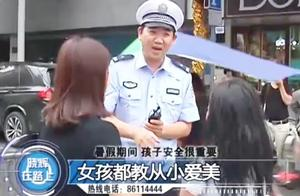 女司机就是不一般,上路带孩子蹿出天窗外,交警不查都不行!