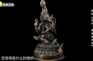 藏友带从美国收来的财神像,专家鉴定为真品,为何他满脸的不情愿