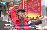 坐着轮椅服务军运 82岁老爹爹争当军运会志愿者