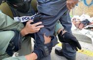 香港媒体联络队警员被弓箭射中左腿,港警发声明谴责暴力行动