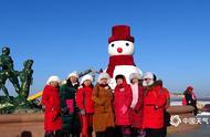 哈尔滨卡通雪人迎新年 造型别致萌翻天