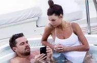 流水的嫩模!44岁小李子泳池约会22岁超模,低头看手机冷落女友
