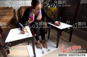 河北邯郸一女子四肢并用写字