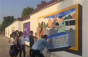 """武汉市武昌区3D城管之星漫画形象""""走""""上围墙"""