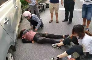 苏州17岁小伙被压车底,20多名路人帮忙救人,太暖心了