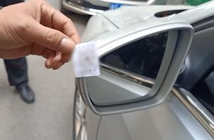 郑州街头多辆车被贴神秘二维码,用手机一扫结果不堪入目