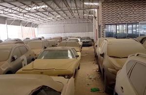 名车坟场:价值百亿的汽车回收站,法拉利保时捷停着积灰