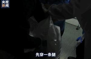 """总台记者探访武汉隔离病房 被感染医护人员比出""""OK"""":请大家放心"""