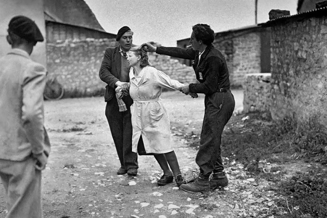 二战时期和外国人恋爱生子,她们被剃头,扒光泼油,石刑致死