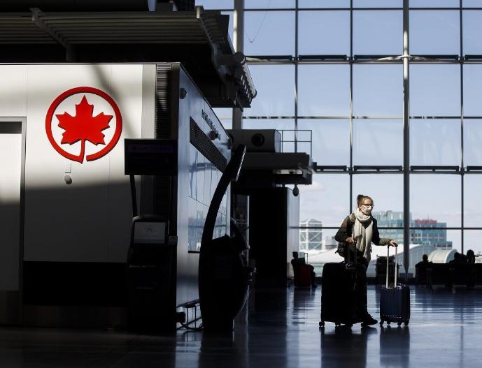 """回中国有""""双阴检测""""也不行,加拿大检测中心被挤爆"""
