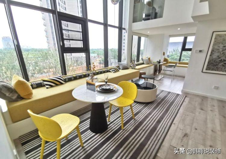 120㎡复式楼中楼,挑高4.8米超大落地窗,一整排的飘窗是最大亮点